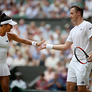 LONDON, ENGLAND - JULY 16: Henri Kontinen of Finland in action with Heather Watson of Great Britain during the Mixed Doubles Final on Center Court during the Wimbledon Lawn Tennis Championships at the All England Lawn Tennis and Croquet Club at Wimbledon on July 16, 2017 in London, England. (Photo by Tim Clayton/Corbis via Getty Images)