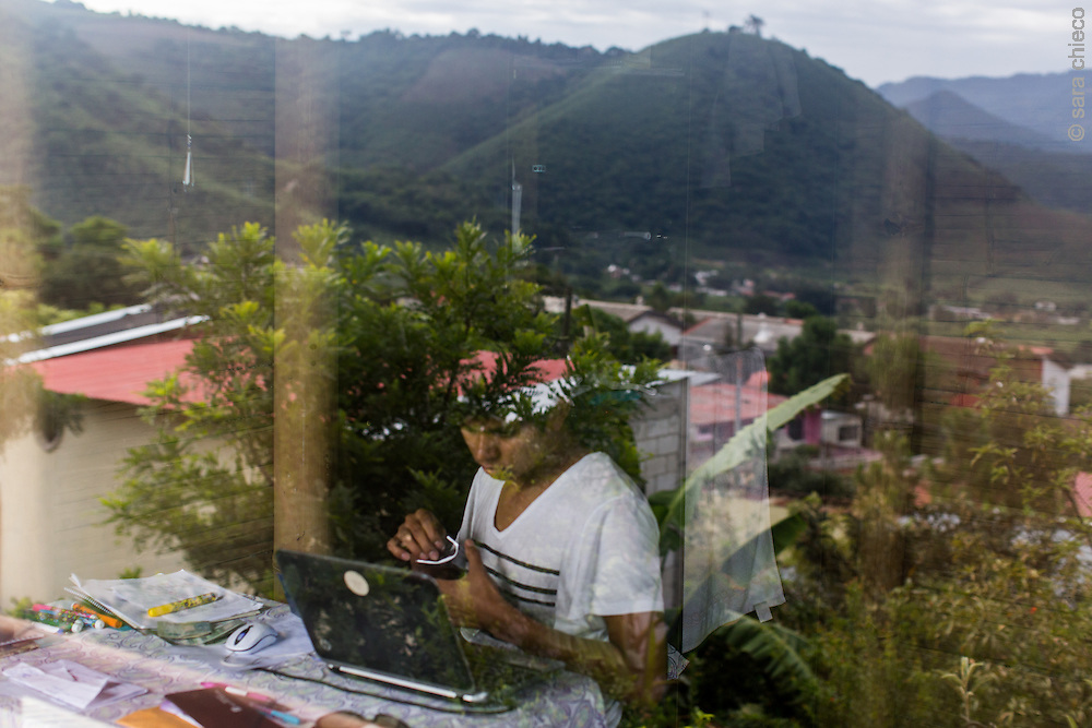 Antonio Cruz Sanchez, 26, works from and lives in the SERES Embassy, a communal living space, where he is a facilitator for SERES, an NGO that trains youth to be leaders against climate change in their local communities. San Juan Del Obispo, Guatemala, July 21, 2014