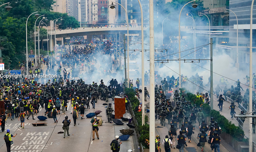 Hong Kong. 29 September, 2019. Illegal march by thousands of pro-democracy supporters from Causeway Bay to Government offices at Admiralty. Police unsuccessfully tried to stop march at start with teargas fired and scuffles. March marked the 5th anniversary of the start of the Umbrella Movement. Police charge demonstrators and make multiple arrests at Admiralty.