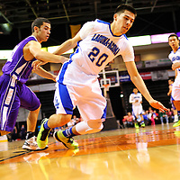 031313  Adron Gardner/Independent<br /> <br /> Laguna Acoma Hawk Austin Jones (20) reaches for a loose ball during the 2A New Mexico High School Basketball tournament quarterfinals at Santa Ana Star Center in Rio Rancho Wednesday.