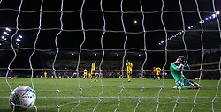 Oxford United's goalkeeper Jonathan Mitchell appears dejected after Manchester City's Phil Foden (out of picture) scores his side's third goal of the game