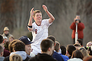 Freedom Plains, NY - Arlington's Rob Stevens gets a ride from the crowd as he celebrates after scoring the winning goal in overtime against Horace Greeley in the Section 9 Class AA boys' soccer championship game on Nov. 7, 2009.