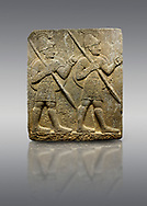 Hittite monumental relief sculpted orthostat stone panel from the Herald's Wall. Basalt, Karkamıs, (Kargamıs), Carchemish (Karkemish), 900-700 B.C. Military parade with soldiers. Anatolian Civilisations Museum, Ankara, Turkey<br /> <br /> Two helmeted soldiers marching soldiers in short skirts carry the shield on their backs and the spears in their hands. .<br />  <br /> If you prefer to buy from our ALAMY STOCK LIBRARY page at https://www.alamy.com/portfolio/paul-williams-funkystock/hittite-art-antiquities.html  - Type  Karkamıs in LOWER SEARCH WITHIN GALLERY box. Refine search by adding background colour, place, museum etc.<br /> <br /> Visit our HITTITE PHOTO COLLECTIONS for more photos to download or buy as wall art prints https://funkystock.photoshelter.com/gallery-collection/The-Hittites-Art-Artefacts-Antiquities-Historic-Sites-Pictures-Images-of/C0000NUBSMhSc3Oo
