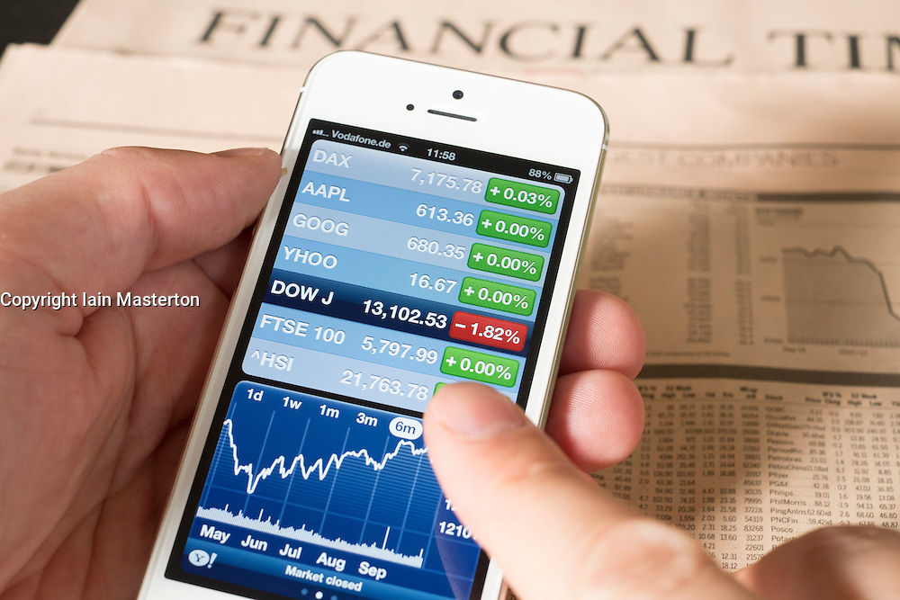 Detail of iPhone 5 smart phone screen showing financial app with Dow Jones  stock market data