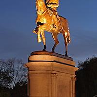 Boston historic landmark photography of the equestrian bronze statue of George Washington in the Boston Public Garden on an early morning in autumn at twilight.<br />