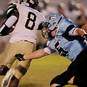 South Brunswick High School's Ian Tenenoff misses a tackle on North Brunswick High School's Bryan Perkins Friday September 13, 2013 at Sough Brunswick High School. (Jason A. Frizzelle)
