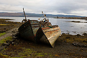 Wrecked fishing boats beached on shore at Salen, Isle of Mull. Lying on their sides, they sit rotting in the harsh northern winters after a lifetime of fishing in the seas off western Scotland. Salen (Scottish Gaelic: An t-Sàilean) is a settlement on the Isle of Mull, Scotland. It is on the east coast of the island, on the Sound of Mull, approximately halfway between Craignure and Tobermory. The full name of the settlement is 'Sàilean Dubh Chaluim Chille' (the black little bay of St Columba).