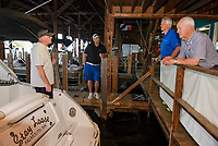 Robert Donovan, Justin Barkley, Bill Irwin and Jack Irwin at the docks at Irwin Marine on Lake Winnipesaukee in Laconia.  (Karen Bobotas for New England Boating Magazine)