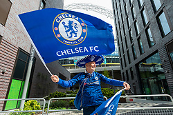 © Licensed to London News Pictures. 15/05/2021. LONDON, UK. A Chelsea fan arrives outside Wembley Stadium ahead of the FA Cup Final between Chelsea and Leicester City.  21,000 fans will attend the match, the most for over a year due to the ongoing coronavirus pandemic and this match will be another data collection exercise for the UK government as it moves to relax lockdown restrictions for major live events.  Photo credit: Stephen Chung/LNP