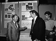 08/01/1988.01/08/1988.8th January 1988 .The Aer Lingus Young Scientist of the Year Award at the RDS, Dublin ..Picture shows Con Power, Director of Economic Policy Confederation of Irish Industry with Michael O Muircheartaigh, sports broadcaster with RTE discussing the project entered by Ciaran Kearnet, St. Louis Grammer School, Ballymena, Co. Antrim, 'The Study and Design of a Hurling Helmet', one of the projects which won a prize sponsored by CII.