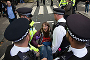 Extinction Rebellion climate change activists are arrested by police as sites around Westminster are blocked on 8th October 2019 in London, England, United Kingdom. Extinction Rebellion is a climate group started in 2018 and has gained a huge following of people committed to peaceful protests. These protests are highlighting that the government is not doing enough to avoid catastrophic climate change and to demand the government take radical action to save the planet.