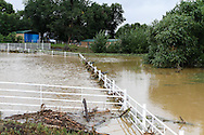 September 15th, 2013:  A view of a horse corral next to a closed portion of Indiana Street at 78th, where flood waters caused by the massive rains Colorado has seen over the last week, have rushed across the road into neighboring yards and fields.