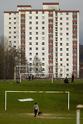 © Licensed to London News Pictures . 18/03/2021. Oldham , UK . GV of Crossley Playing Fields , overlooked by Stockfield Mount tower block . Exploring a year of experiences , lessons and consequences of Coronavirus in the NW of England . Photo credit : Joel Goodman/LNP