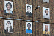 Condemned housing in Dalston/Hackney whose former residents are celebrated in a series of photography portraits before the demolition of their old homes. Commissioned portrait prints of the people who used to live here have been posted into their apartment windows, long after their departure, making way for a new development that will contribute to the changing face of Hackney, one of London's poorest and largest boroughs – a year before the 2012 Olympiad, a few miles away in Stratford.