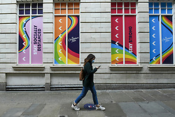 © Licensed to London News Pictures. 26/09/2020. LONDON, UK. A shopper wearing a facemask passes social distancing signs in the West End of the capital.  As the number of coronavirus cases continues to rise heralding a second wave of the pandemic, it is reported that London may soon face more comprehensive lockdown restrictions.  Photo credit: Stephen Chung/LNP