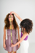 tailored Service one woman measures the body of another woman with a tape measure