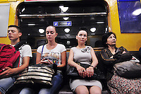 A study in faces on a green line train. With 5 lines, the metro in St. Petersburg, Russia is fast, clean, and efficient. Built deep and made to last, the system serves the five million residents of this sophisticated city well.
