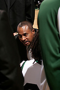 Cleveland State University Head Coach Gary Waters talks to his players in a huddle during a time out.