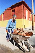 Man with wheelbarrow in Gibara, Holguin, Cuba.
