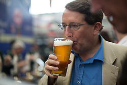 © licensed to London News Pictures. London, UK 13/08/2013. People drinking different kinds of beer as they visit The Great British Beer Festival 2013 organised by Campaign for Real Ale (CAMRA) at Olympia, London. The event offers visitors more than 800 real ales, ciders, perries and foreign beers to try. 55,000 people are expected to attend this year's Great British Beer Festival. Photo credit: Tolga Akmen/LNP