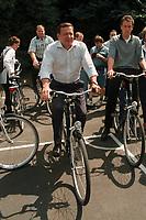 """16 JUL 1999 - LINZ, GERMANY:<br /> Gerhard Schröder, Bundeskanzler, mit Fahrrad, während der SPD Radtour """"Abschied vom Rhein""""<br /> Gerhard Schroeder, Fed. Chancellor Germany, with bike during a trip with a part of the SPD parliamentary group to a """"Goodbye from Rhine"""" tour <br /> IMAGE: 19990716-01/12-18"""