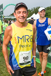 Beach to Beacon 10K: race director Dave McGillivray after running in race, wearing singlet of Martin Richard, 8 year old boy killed in the 2013 Boston bombings