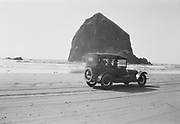 1307B-62 Car at Haystack rock, Cannon Beach. 1917 license plate.
