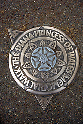 21 April 2011. London, England..The plaque in the pavement showing where The Diana Princess of Wales memorial walk runs beside the Mall near  Buckingham Palace in the run up to Catherine Middleton's marriage to Prince William..Photo; Charlie Varley.