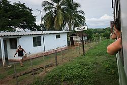 26 September 2015, Trinidad, Cuba: An old but functional commuter train runs through the countryside villages near Trinidad.