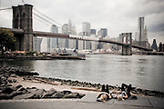 Two girls are lying on the top of the stairs of the Brooklyn Bridge Park in DUMBO, New York, 2010.