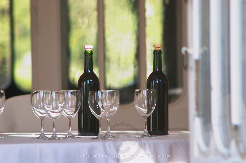 A table set with glasses and bottles for tasting wine, sunshine and shade, summer - Chateau Belgrave, Haut-Medoc, Grand Crus Classe 1855