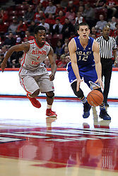 07 January 2015:  Reed Timmer handles the ball as he approaches the paint with Paris Lee by his side during an NCAA MVC (Missouri Valley Conference) men's basketball game between the Drake Bulldogs and the Illinois State Redbirds at Redbird Arena in Normal Illinois.  Illinois State comes out victorious 81-45.