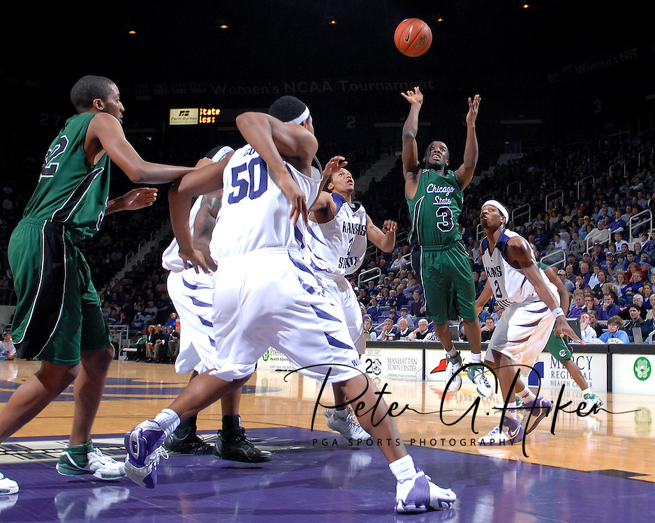 Chicago State guard David Holston (C) puts up a shot in the first half over Kansas State's Cartier Martin (R), Lance Harris (L) and Luis Colon (50) at Bramlage Coliseum in Manhattan, Kansas, January 22, 2007.  K-State beat Chicago State 73-36.