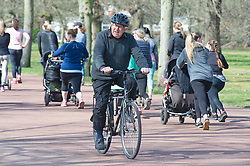 © Licensed to London News Pictures 13/04/2021. Greenwich, UK. A man riding round the park on his bike. People enjoying the sunny weather and exercising in Greenwich Park, London as coronavirus lockdown restrictions continue to ease in the UK. Photo credit:Grant Falvey/LNP