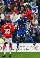 Photo: Steve Bond.<br />Leicester City v Barnsley. Coca Cola Championship. 27/10/2007. Lewin Nyatanga (L) outjumps Collins John (C)