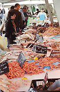 On Quai des Chartrons. A street market. Fish and shellfish at a fishmongers On Les Quais. Bordeaux city, Aquitaine, Gironde, France