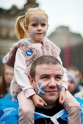 © Licensed to London News Pictures. 16/09/2014. Glasgow, UK. A child attending and father to a mass meeting by Yes voters and campaigners at George's Square in Glasgow city centre on the evening of Tuesday, 16 September, two days ahead of the Scottish independence referendum. Photo credit : Tolga Akmen/LNP