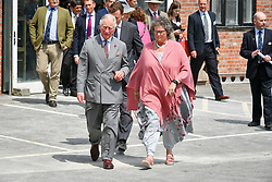 The Prince of Wales walks with Director of Dorset Centre for the Creative Arts Sarah Drew, during a visit to the Dorset Centre for the Creative Arts on Middle Farm Way, in Poundbury, Dorchester.