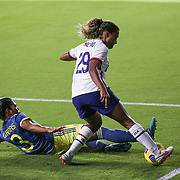 ORLANDO, FL - JANUARY 22:  Catarina Macario #29 of United States avoids the tackle from Daniela Arias #3 of Columbia at Exploria Stadium on January 22, 2021 in Orlando, Florida. (Photo by Alex Menendez/Getty Images) *** Local Caption *** Catarina Macario; Daniela Arias