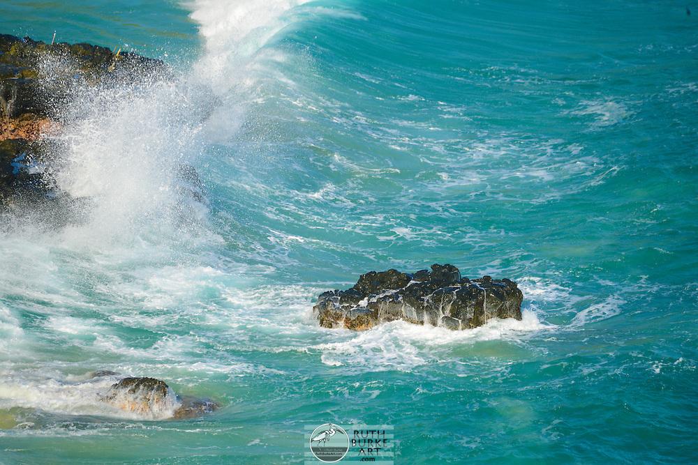 Coastline of the island of Ohau in Hawaii showing ocean vistas and surf.