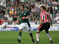 Photo: Lee Earle.<br /> Southampton v Plymouth Argyle. Coca Cola Championship. 24/09/2005. Southampton's Matthew Oakley (R) keeps his eye on the ball as Tony Capaldi tries to get past.