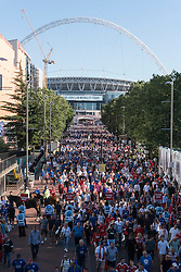 © Licensed to London News Pictures. 07/08/2016. Manchester United and Leicester City football fans leave Wembley Stadium and walk down Wembley Way after attending the Charity Shield football match. London, UK. Photo credit: Ray Tang/LNP