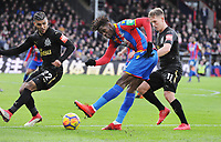 Football - 2017 / 2018 Premier League - Crystal Palace vs. Newcastle United<br /> <br /> Wilfried Zaha of Palace with DeAndre Yedlin (22) and Matt Ritchie (11), at Selhurst Park.<br /> <br /> COLORSPORT/ANDREW COWIE