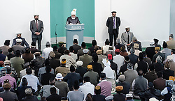 © Licensed to London News Pictures. 21/09/2012. London,UK.  His Holiness Hadhrat Mirza Masrror Ahmad gives a sermon at the Baitul Futuh Mosque in Morden, London, in the wake of  protests across the Islamic world against the film 'Innocence of Muslims'.  His Holiness Hadhrat Mirza Masrror Ahmad is the Khalifa and worldwide muslim leader for Islam.   The Baitul Futuh Mosque is the largest mosque in Europe   Photo credit : Richard Isaac/LNP