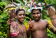 Young Mbore males hold drums during a community celebration marking the Mborena Kam New Testament dedication on July 26, 2017, in Madang Province, Papua New Guinea. The work to translate the New Testament into this language, one of more than 800 in Papua New Guinea, took over 30 years.