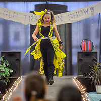 Lolo Burnham walks the runway in a dress made of caution tape during the McKinley Citizens' Recycling Council Trashion Show at the Rio West Mall in Gallup Saturday.