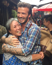 """David Beckham releases a photo on Instagram with the following caption: """"Making friends in Bangkok \ud83c\uddf9\ud83c\udded \u2764\ufe0f"""". Photo Credit: Instagram *** No USA Distribution *** For Editorial Use Only *** Not to be Published in Books or Photo Books ***  Please note: Fees charged by the agency are for the agency's services only, and do not, nor are they intended to, convey to the user any ownership of Copyright or License in the material. The agency does not claim any ownership including but not limited to Copyright or License in the attached material. By publishing this material you expressly agree to indemnify and to hold the agency and its directors, shareholders and employees harmless from any loss, claims, damages, demands, expenses (including legal fees), or any causes of action or allegation against the agency arising out of or connected in any way with publication of the material."""