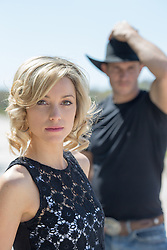 beautiful blonde girl and a cowboy