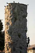 Children climb a rock climbing wall during the National Night Out event hosted by Cathedral of Faith Milpitas at Selwyn Park in Milpitas, California, on August 7, 2014. (Stan Olszewski/SOSKIphoto)