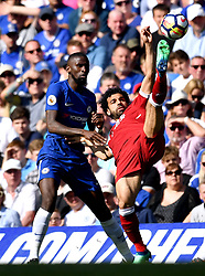 Chelsea's Antonio Rudiger (left) and Liverpool's Mohamed Salah battle for the ball during the Premier League match at Stamford Bridge, London.